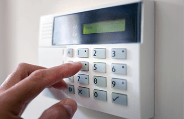 person arming an alarm system